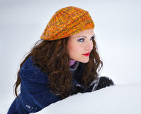 Young woman hiding in snow Stock Photography