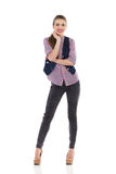 Young woman in high heels and jeans waistcoat Stock Photography