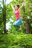 Young woman high jumps Royalty Free Stock Photos