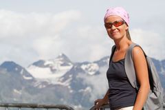 Young woman high in the mountains Royalty Free Stock Photo