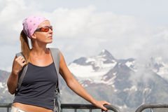 Young woman high in the mountains Royalty Free Stock Image