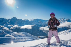 Young woman in high mountains. Winter Royalty Free Stock Photo
