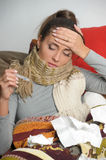 The young woman with high temperature is ill Royalty Free Stock Images
