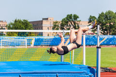 Young woman in highjump Stock Image