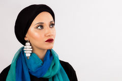 Young Woman in hijab and colorful scarf. Arabic woman with high fashion make up wearing hijab, colorful scarf and fashion earrings Stock Photography