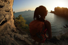Young woman hiker enjoy the view on sunset seaside Royalty Free Stock Photography