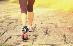 Young woman hiker feet walking rural trail Royalty Free Stock Photography