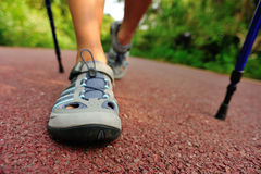 Young woman hiker feet walking rural trail Stock Photos