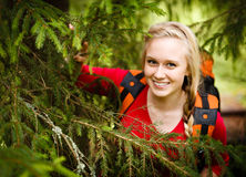 Young woman hiker hiding under a tree royalty free stock photo