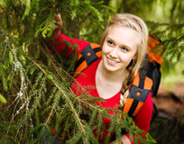Young woman hiker hiding under a tree Stock Photography