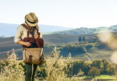 Young woman hiker hiking in Tuscany taking binoculars Stock Photos