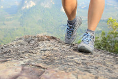 Young woman hiker legs climbing at mountain peak Royalty Free Stock Images