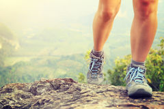 Young woman hiker legs on mountain peak Stock Images