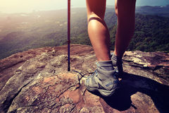 Young woman hiker legs on mountain peak Stock Image