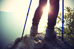 Young woman hiker legs on mountain peak Royalty Free Stock Photography