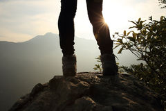 Young woman hiker legs on sunrise mountain peak Royalty Free Stock Photography