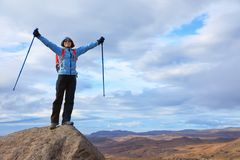 Young woman hiker in the mountains Stock Image