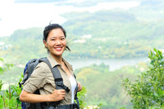 Young woman hiker moutain peak Stock Image
