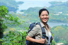 Young woman hiker moutain peak Stock Photo