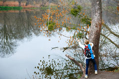 Young woman hiker near autumn river Royalty Free Stock Images