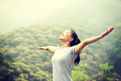 Young woman hiker open arms at moutain Stock Images