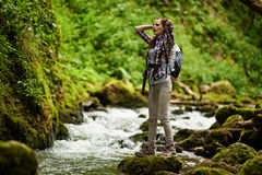 Young woman hiker by the river Royalty Free Stock Photography