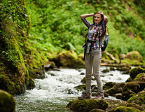 Young woman hiker by the river Stock Photo
