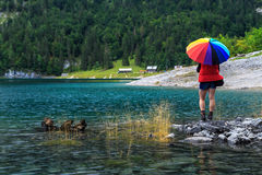 Young woman hiker standing on the stones,Gosausee,Salzkammergut,Austria Stock Image