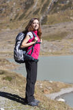 Young woman hiker on the Swiss alps Stock Photo
