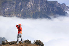 Young woman hiker taking photo Royalty Free Stock Images
