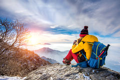 Young woman hiker taking photo with smartphone on mountains peak. Stock Photography