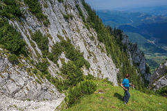 Young woman hiker trekking in Piatra Craiului Royalty Free Stock Photography