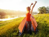 Young woman hiker wakes up and stretches Royalty Free Stock Photography