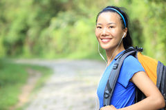 Young woman hiker walking rural trail Royalty Free Stock Photos