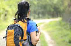 Young woman hiker walking rural trail Stock Image