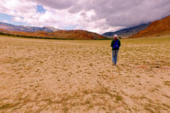 Young woman hiking Altai. Young caucasian woman walking (hiking) among beautiful summer desert, steppe and mountain landscape (Altai territory, Russia) under Royalty Free Stock Image