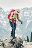 Young woman hiking with backpack at mountains Royalty Free Stock Photo