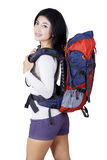 Young woman with hiking bag in studio Royalty Free Stock Images