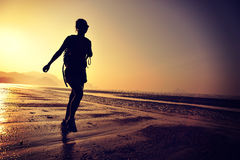 Young woman hiking on beach Royalty Free Stock Photo