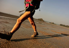 Young woman hiking on beach Stock Images