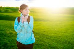 Young woman hiking in beautiful nature. Sports and healthy lifestyle concept stock images