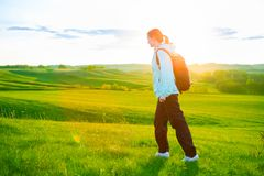Young woman hiking in beautiful nature. Sports and healthy lifestyle concept stock photography