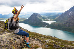 Young woman hiking on Besseggen. Happy girl enjoy beautiful lake and good weather in Norway. Royalty Free Stock Photos