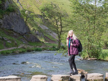 Young woman hiking in Dovedale Royalty Free Stock Image