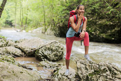 Young woman hiking in forest Stock Image