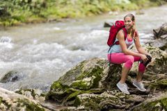 Young woman hiking in forest stock images