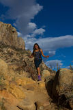 Young woman hiking Granite Mountain in Arizona Stock Photo