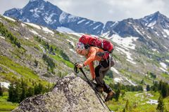 Young woman is hiking in highlands of Altai mountains, Russia Stock Photos