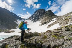 Young woman is hiking in highlands of Altai mountains, Russia Stock Images