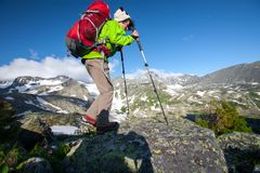 Young woman is hiking in highlands of Altai mountains Royalty Free Stock Photography